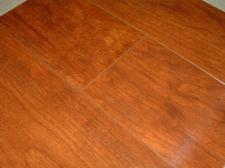 Horizon Williamsburg Cherry laminate from Flooring America close up photo