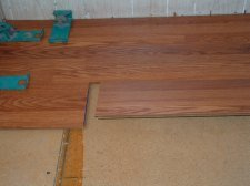 This is the first step to connect the Pergo Casual Living laminate flooring planks together.