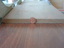 14 mm Toklo laminate flooring compared to a penny
