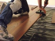 Swiftlock Plus Laminate from Lowes, tapping together the end joint.