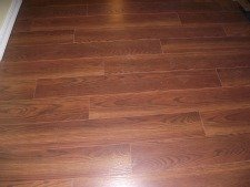 Swiftlock Plus 8MM laminate flooring from Lowes. Underlayment attached to the bottom, EastPort Oak Auburn
