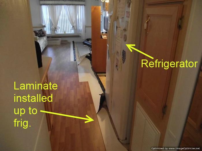 Laminate flooring in kitchen over ceramic tile installation